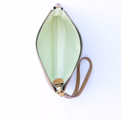 Inside view of caramel iconic wristlet featuring stunning light green lining